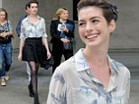 The Dark hemline Rises! Anne Hathaway flashes enviably long pins in peplum skirt and patterned blouse as she leaves BBC studios