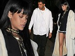 The lady is at Tramp! Rihanna wears a pair of barely there micro shorts as she joins boyfriend Drake at afterparty for his show