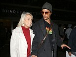 Momma's boy! Matthew McConaughey holds hand with his mother as they jet into LAX following brief trip to Rome