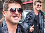 What separation? Robin Thicke gives a happy thumbs up despite wife Paula Patton still 'not convinced' to him back