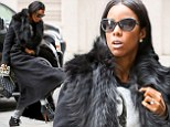 Dressed like a Commander: Kelly Rowland demands attention as she stomps around in lace-up stilettos with five inch heels