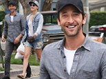 Outing: Adrien Brody relaxes with a mystery blonde walking on Melrose in Los Angeles