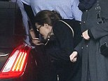 Undercover: Angelina Jolie, pictured being escorted into a Government car before her meeting with William Hague