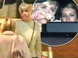 Double trouble! Bad girls Miley Cyrus and Emma Roberts bond during a friendly dinner out on the town