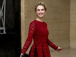Pretty as a picture: Lily James shows off her dress as she twirls at the Changing Faces Gala Dinner at London's Bloomsbury Ballroom
