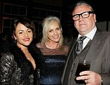 Family man: Ray looked pleased as punch to be joined by wife Elaine and daughter Jaime at the Noah after party