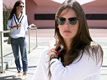 Preppy chic! Alessandra Ambrosio keeps it sporty in a cricket-inspired jumper for a girls lunch