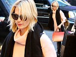 Life is peachy! January Jones let her striking bag do the talking on Wednesday night as she stepped out in New York City with the peachy/apricot shade accessory on her arm