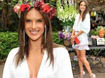 A bit of all white! Alessandra Ambrosio takes the plunge in cleavage baring playsuit at handbag launch