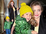 Brights in the Big Apple! Miranda Kerr is a ray of sunshine in a yellow shift dress as she dresses cheeky son Flynn in a standout green jacket