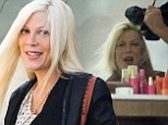 Tori Spelling spoils herself at pricey hair salon... despite husband Dean McDermott trying to curb her spending