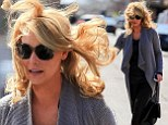 Katherine Heigl has a hair raising moment when gust of wind messes up her chic appearance