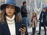 Smile, that's the Berlin Wall! Ever stylish Jessica Alba snaps away on her camera during family trip to historic landmark