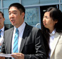 Matthew, left, and Grace Huang, an American couple charged with starving to death their 8-year-old adopted daughter, speak to the press outside the a courtho...