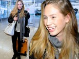 Perfect timing! Dylan Penn arrives in Madrid 'amid rumours of romantic hook-up with on-again flame Robert Pattinson'