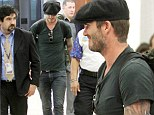 Casual attire: David Beckham dressed down in a black T-shirt and jeans combination as he departed Miami following a few days of business meetings