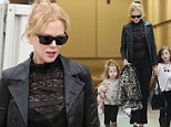 Nicole Kidman arrives in Sydney on Thursday with daughters Sunday Rose and Faith Margaret