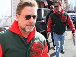 Russell Crowe proudly dons South Sydney Rabbitohs jacket as he steps out in New York City