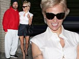 Showing him up! Pamela Anderson shines in sexy shorts while new husband Rick Solomon slobs around in sweats