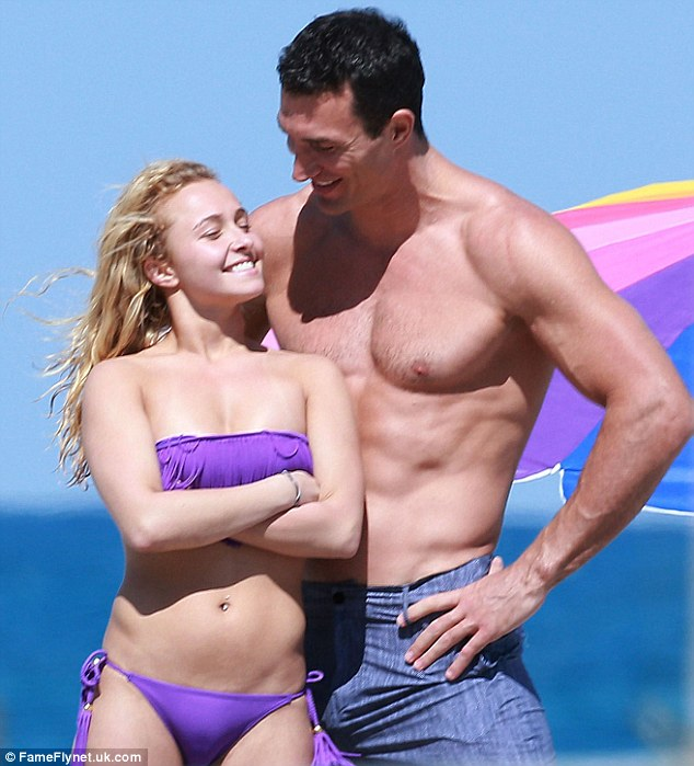 What's so funny? The loved-up pair giggled as they shared a joke on their day at the beach
