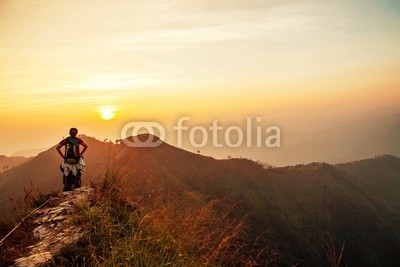 traveler stand on top of mountain when sunset
