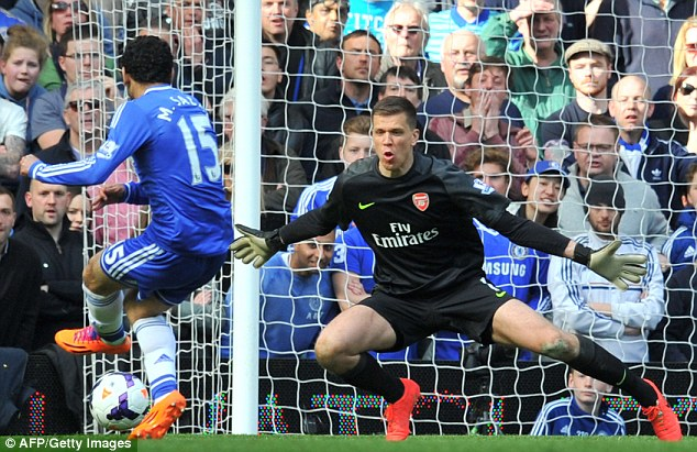 Six up: Mohamed Salah slots past Szczesny in the second-half to compound Arsenal's misery