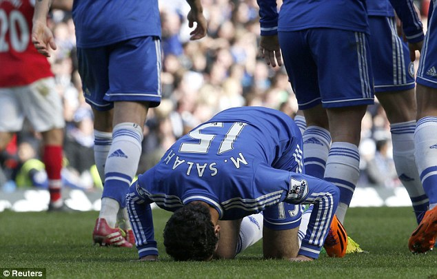 Bow down: Salah celebrates after scoring his first goal for Chelsea in the win