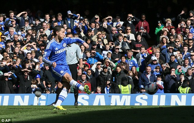 Slotted home: Hazard composed himself to score the penalty and put Chelsea 3-0 up