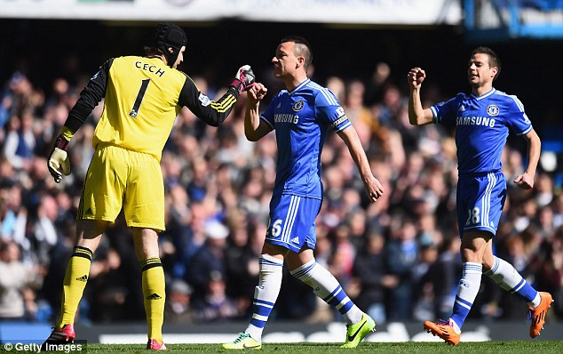 Credit: John Terry and Cesar Azpilicueta congratulate Petr Cech after his save just before the first goal