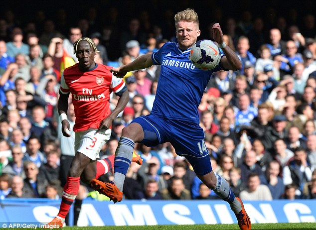 Running on: Schurrle stretches for the ball as Sagna looks on at Stamford Bridge