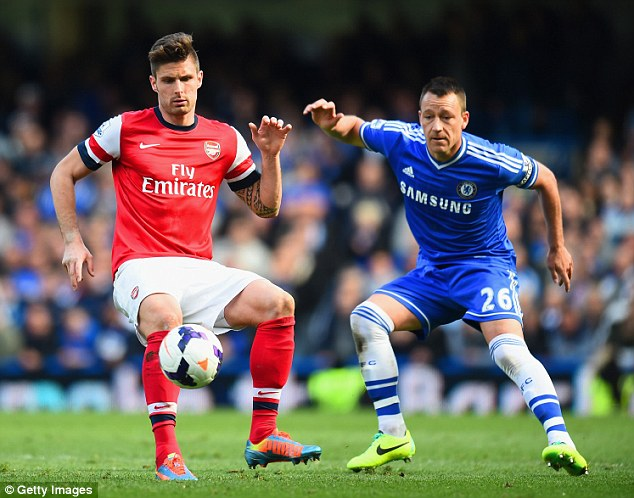 Touch: Giroud looks to control the ball under the watchful eye of John Terry