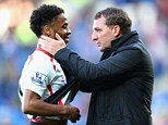Title challenge: Rodgers congratulates Raheem Sterling after last weekend's 6-3 win at Cardiff