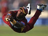Safe hands: Bravo is at full stretch to take Faulkner's wicket
