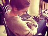 Emma Watson gets cosy with a cute bunny ahead of Noah film premiere