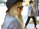 Ashlee Simpson looks stylish in a large black fedora and grey blazer as she visits sister Jessica's office in Westwood