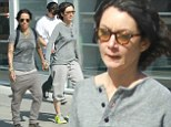 Coordinated: Sara Gilbert and her fiancé Linda Perry both dressed in head-to-toe grey and held hands as they went shopping in Beverly Hills