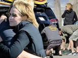 Mr. Fix it: Helen Hunt ripped the bumper off her black Toyota Prius when she reversed into another vehicle, only to have her boyfriend of 13 years, Matthew Carnahan, step in to repair some of the damage