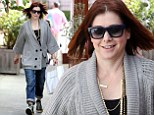 She's still celebrating! Alyson Hannigan dresses up her grey sweater with a layering of necklaces to grab gourmet lunch to-go