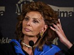 Slip-up: Sophia Loren ran her fingers through her hair and she inadvertently revealed that her natural tresses had been enhanced with a wig