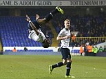 High flying: Souleyman Coulibaly celebrates opening the scoring against Arsenal at White Hart Lane