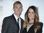 Darren Fletcher and his wife Hayley pose outside Old Trafford