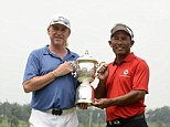 In with the new: Team Europe captain Miguel Angel Jimenez and Team Asia captain Thongchai Jaidee pose with the EurAsia trophy at the inaugral tournament held in Kuala Lumpur
