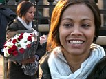 Pleasant surprise! Zoe Saldana received a large bouquet of roses on set of Rosemary's Baby in Paris, France on Thursday
