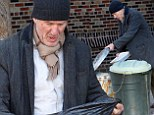 Richard Gere rifles through trash cans in scruffy clothes... but don't worry, it's only for a new movie