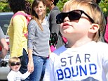 Anything for my kids! Jennifer Garner squints against the sun as she lends her stylish shades to her young son Samuel