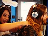 Heavenly hands: 2DayFM host Maz Compton gives Jared Leto a shoulder massage on Friday during an angelic themed on-air segment