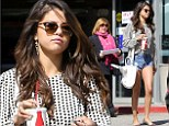 Brunette beauty: Selena Gomez was seen showcasing her slim pins while out in Los Angeles on Thursday