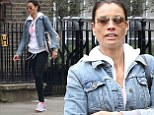 'Arms, abs and back... Have it!': Melanie Sykes teams black leggings and pink vest with pale denim jacket as she heads to the gym