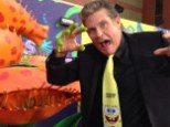 Getting slimed: Hasselhoff showed off his zany side, dipping his fingers into the slime