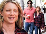 Dressed down, loved up! Make-up free Amy Smart can't keep her hands off hunky husband Carter Oosterhouse on coffee run